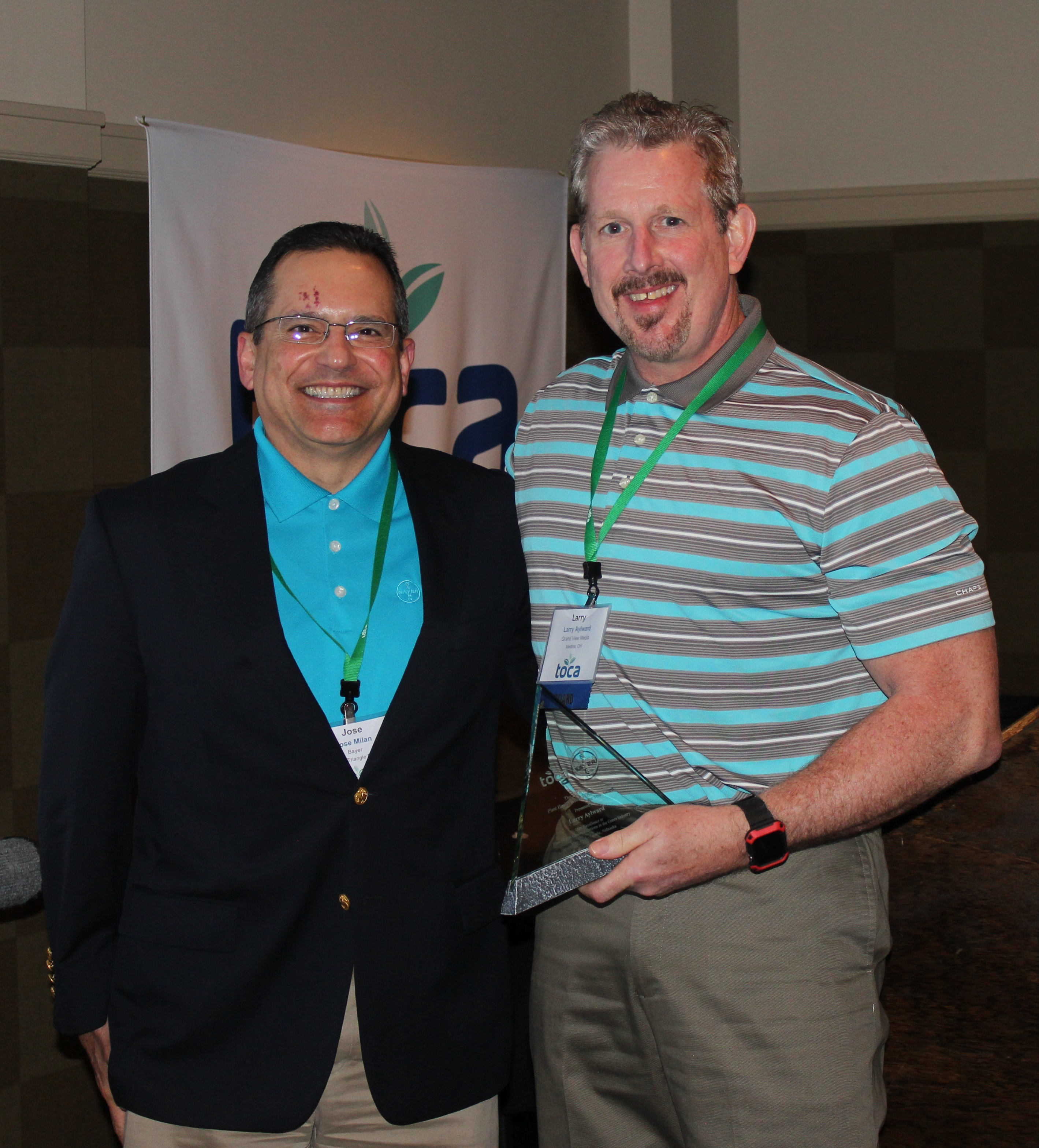 The 2016 Plant Health Writer of the Year, Larry Aylward (right), with Jose Milan of Bayer.